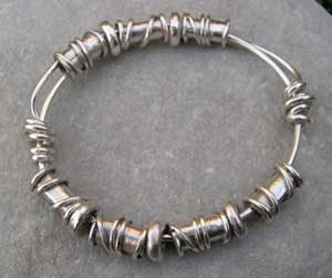 Silver Expanding bangle with handmade beading