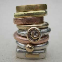 Silver and gold designer rings
