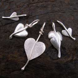 five silver heart pendants