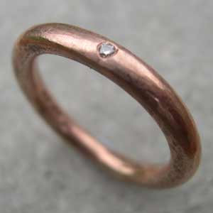 single diamond eternity ring in 9ct red gold