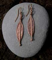 red gold leaf design earrings