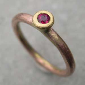 Ruby Engagement Ring  set in yellow gold on a red gold shank