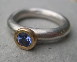 designer engagement ring with sapphire