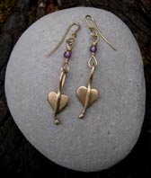 designer gold heart earrings
